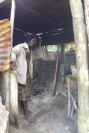 Winston showing me the inside of his stall where he is roasting a breadfruit