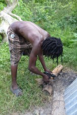 scraping the burnt breadfruit